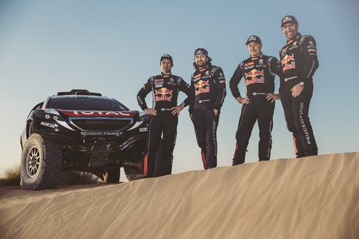 Cyril Despres, David Castera, Jean-Paul Cottret and  Stephane Peterhansel  pose for a portrait during the Peugeot test in Arfoud, Morocco, on June 16th, 2015